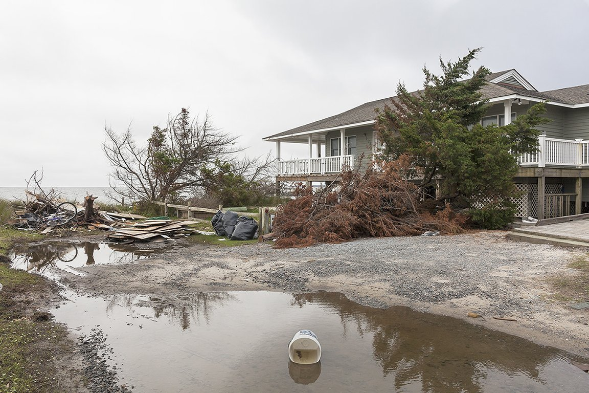 Beach House Damaged by Hurricane Dorian, 198 Pintail Drive, Ocracoke Island, North 	Carolina, 2019. Elevation Three Feet. N 35.11757 W 75.97319