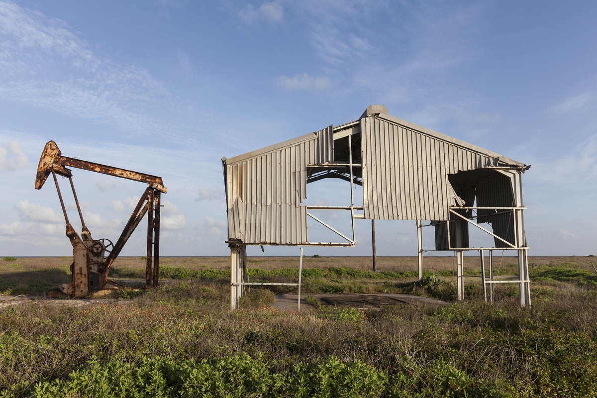 Derelict Oil Well and Building Damaged by Hurricane Ike, Bolivar Peninsula,  Texas, 2014. Elevation Eight Feet. N 29.48473 W 94.56014.