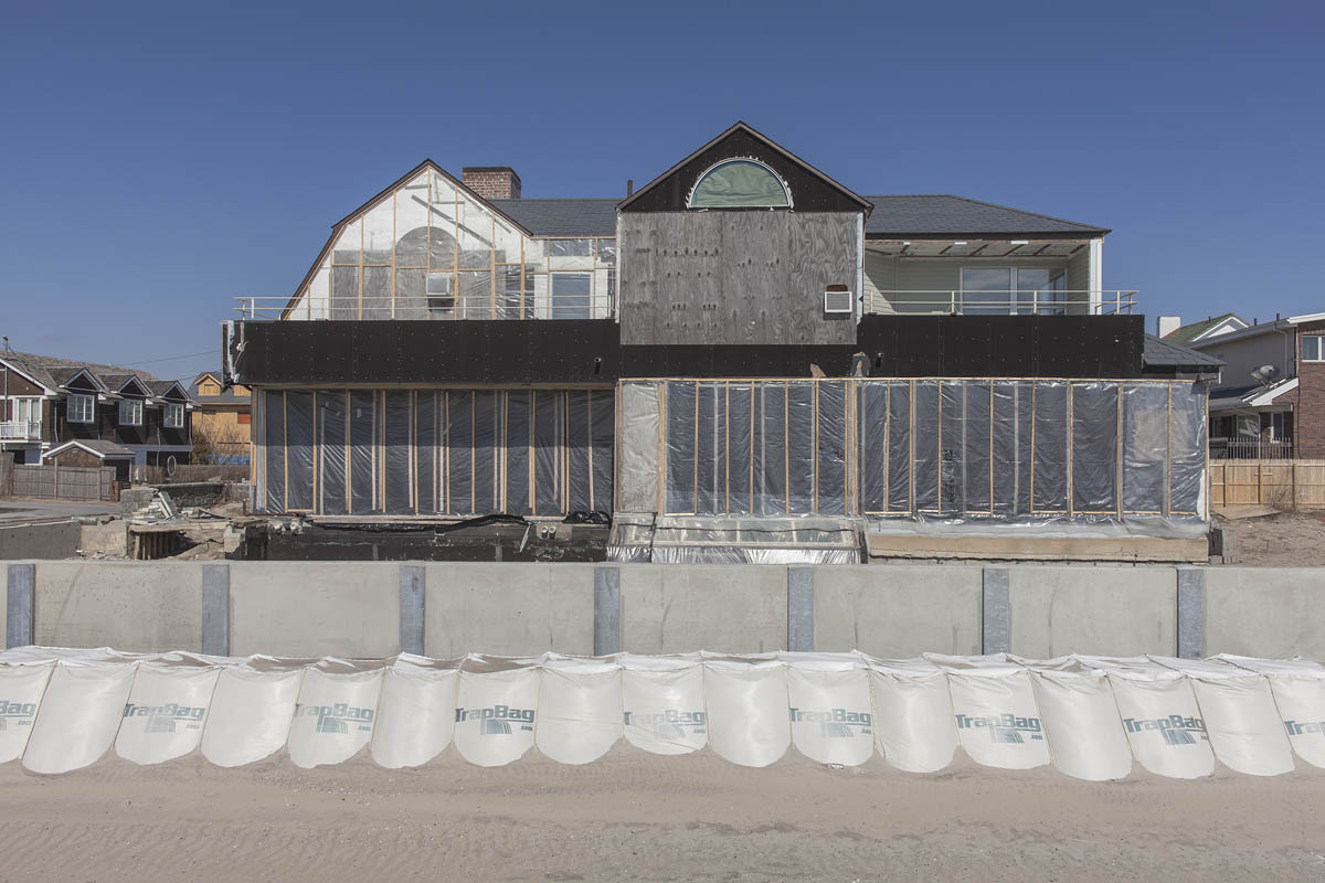 New Seawall and Damaged House, 136 B144 Street, Rockaways, New York, 2014.  Elevation Nine Feet. N 40.56934 W 73.85868.