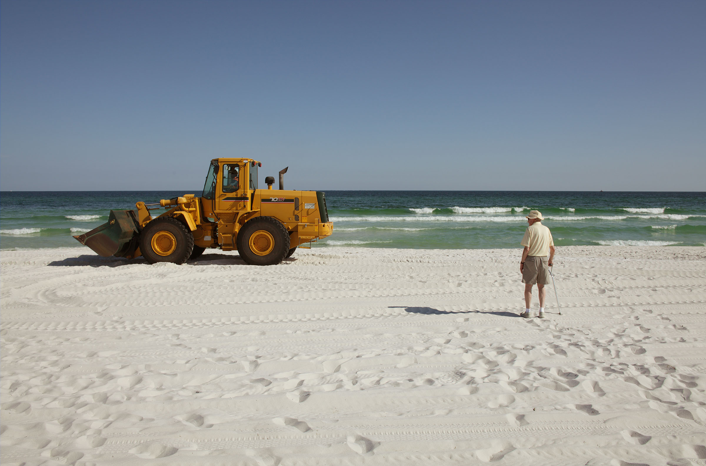 Resident Watching front end loader, BP clean-up, Pensacola Beach, Florida, 2010