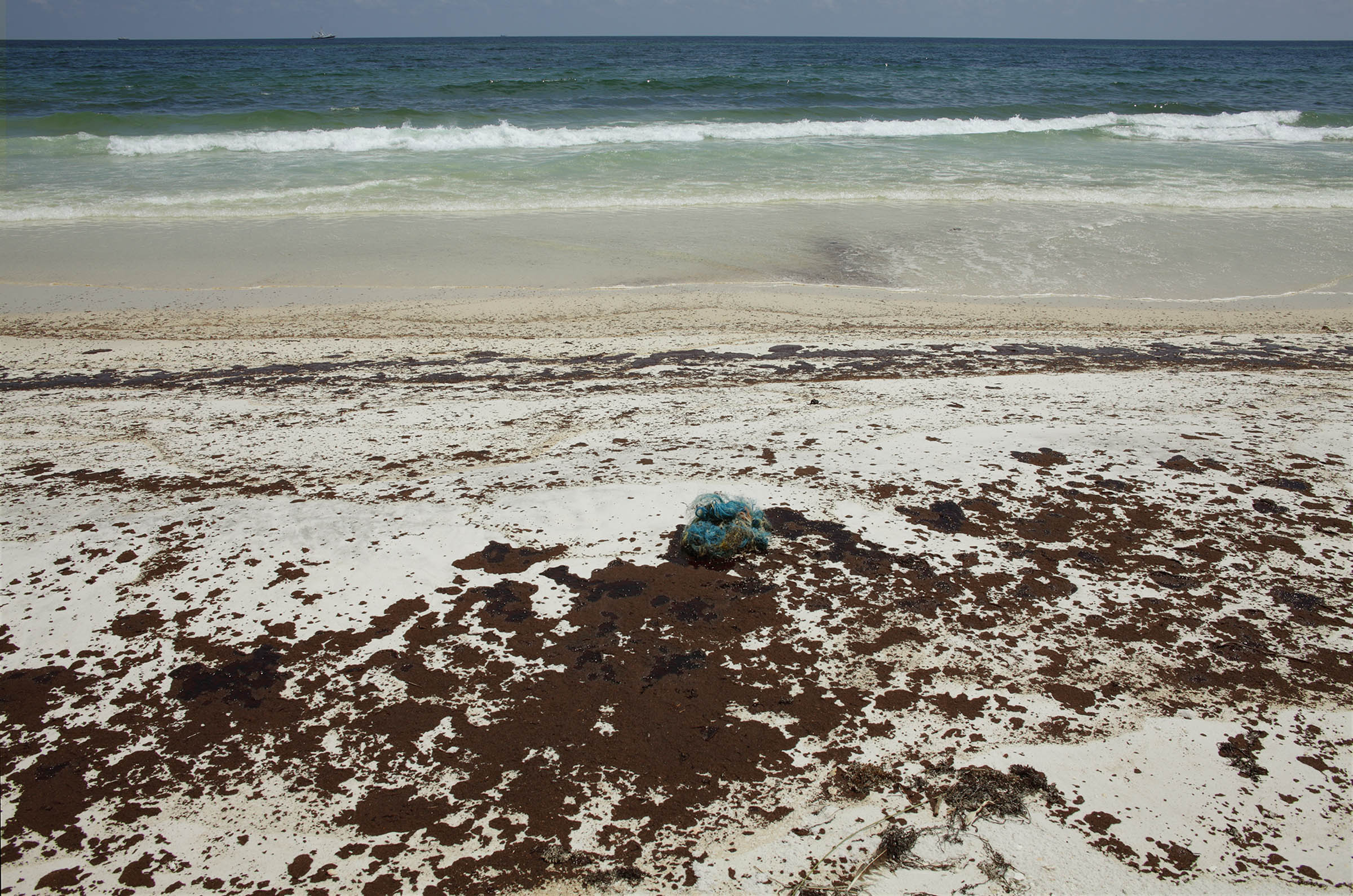 BP Oil and fishing net washed up on shoreline, National Sea Shore Park, Santa Rosa Island, Florida, 2010