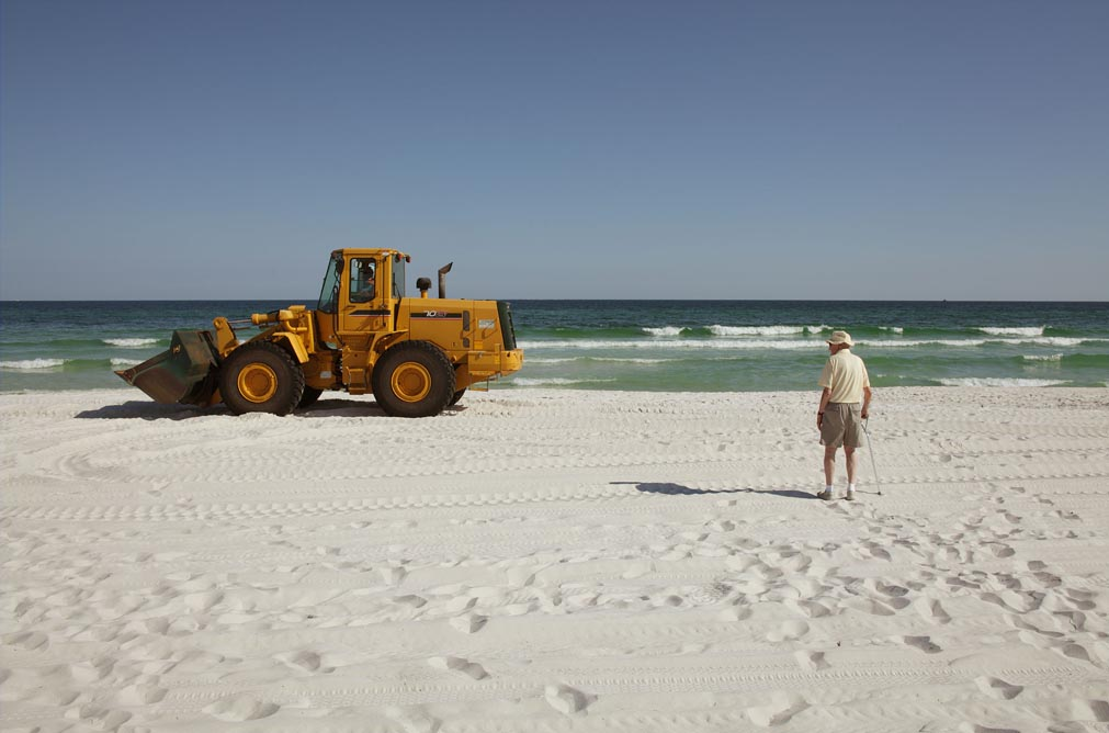 16-resident-watching-front-end-loader-bp-clean-up-pensacola-beach