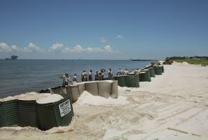 Troops erecting protective oil spill barriers, Fort Morgan, Alabama 2010